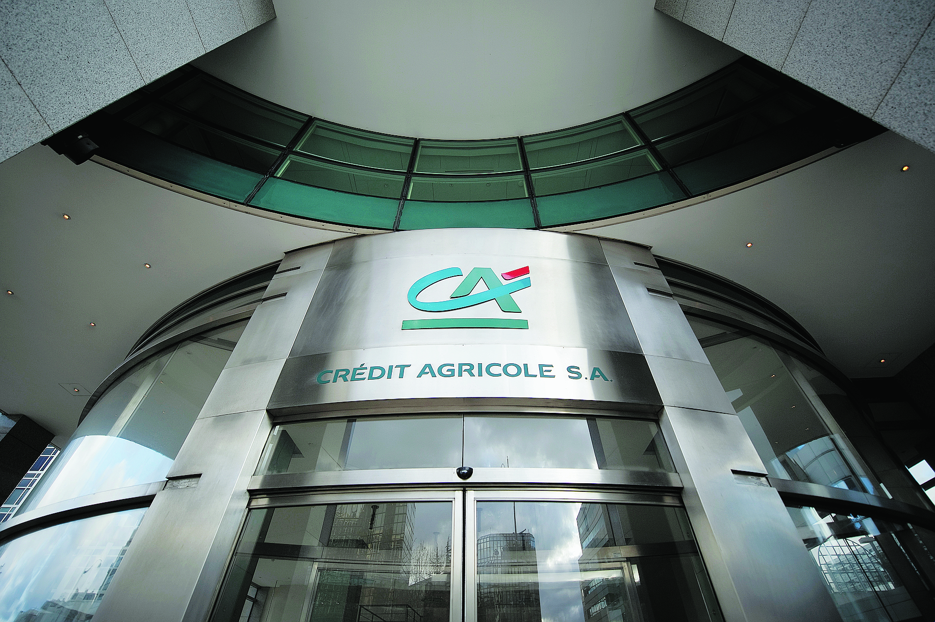A picture taken on December 14, 2011 in Paris shows the entrance of former headquarters of the French bank Credit Agricole. French banking group Credit Agricole is to cut 2,350 jobs around the world, including 850 positions in France, mainly at its Cacib investment bank, the Force Ouvriere (FO) union said today. At Cacib, 1,750 jobs will be cut globally, including 550 in France, said FO's representative for the bank, Bernard Pechard. AFP PHOTO  / LIONEL BONAVENTURE